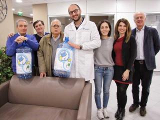 Il dr Pellini e alla sua sinistra il dr Miele dell'Aucc